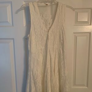 2 Free People Lace Dresses. One black, one white.